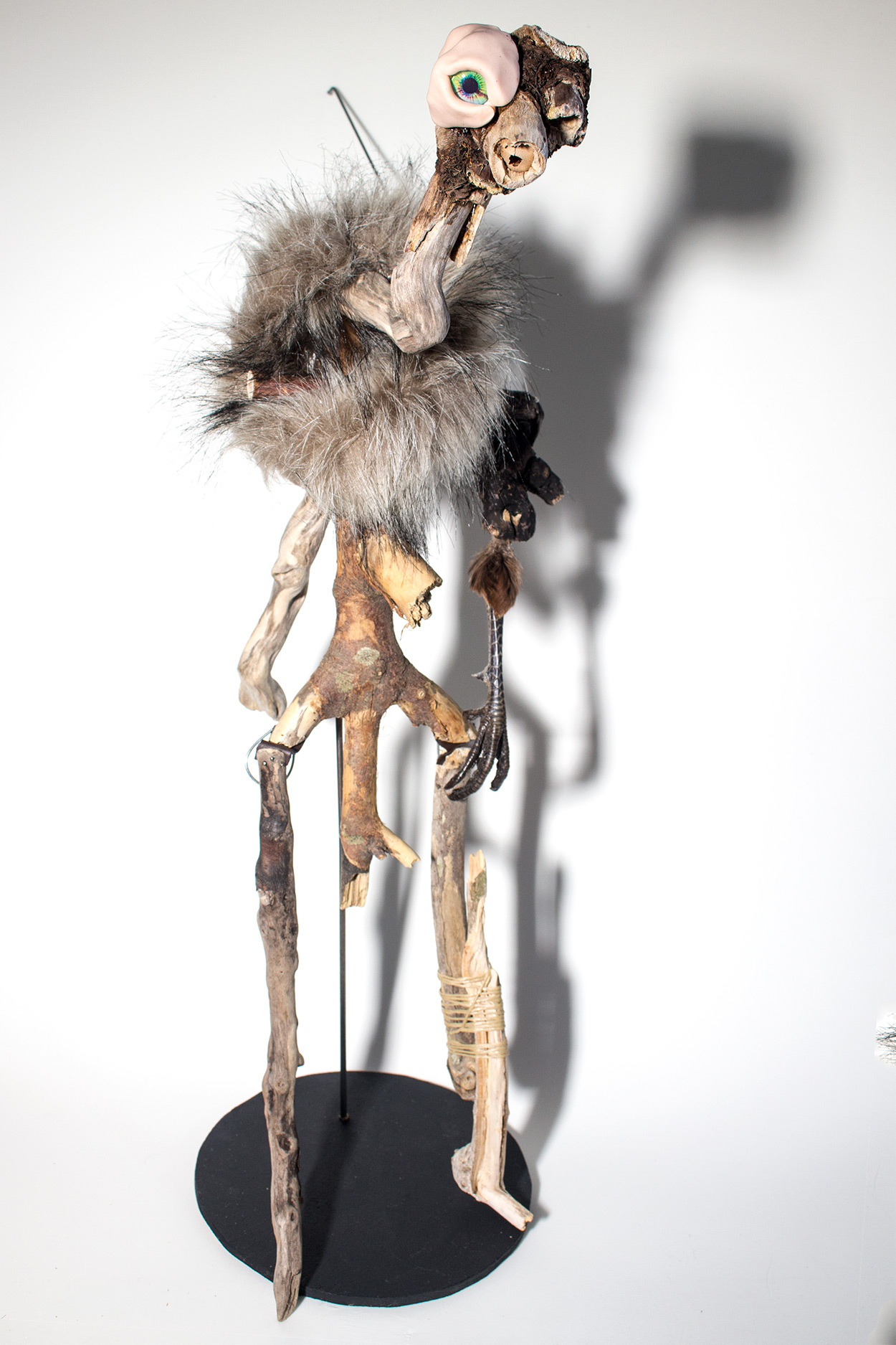 An artist's puppet made from driftwood and taxidermy